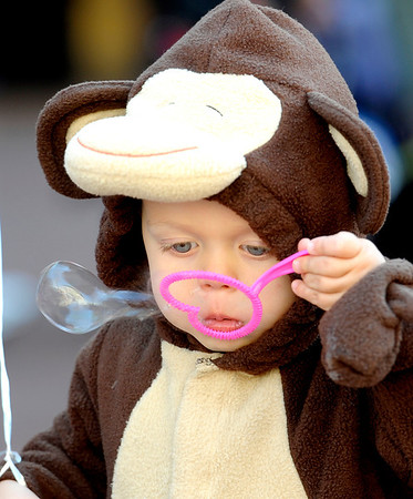 Lincoln Facteau, 21 months, blows bubbles during the Munchkin Masquerade on the Pearl Street Mall in Boulder, Colorado October 31, 2011.  CAMERA/Mark Leffingwell