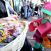 Mazzy Egenthal, 2, eyes a pack of Skittles she got while Trick or Treating during the Munchkin Masquerade on the Pearl Street Mall in Boulder, Colorado October 31, 2011.  CAMERA/Mark Leffingwell