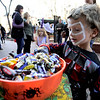 Erik Fahrenholtz, 4, picks out some candy during the Munchkin Masquerade on the Pearl Street Mall in Boulder, Colorado October 31, 2011.  CAMERA/Mark Leffingwell