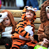 "Pia Mortimer (left), 13 months, Jayden ""Munch"" Beyer (middle), 23 months and Cassin Rossenblum (right), 2, take a rest during the Munchkin Masquerade on the Pearl Street Mall in Boulder, Colorado October 31, 2011.  CAMERA/Mark Leffingwell"