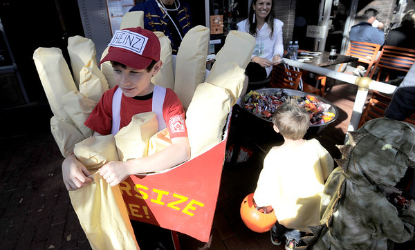 Kenton Kaplan, 10, trick or treats in a french fry costume during the Munchkin Masquerade on the Pearl Street Mall in Boulder, Colorado October 31, 2011.  CAMERA/Mark Leffingwell