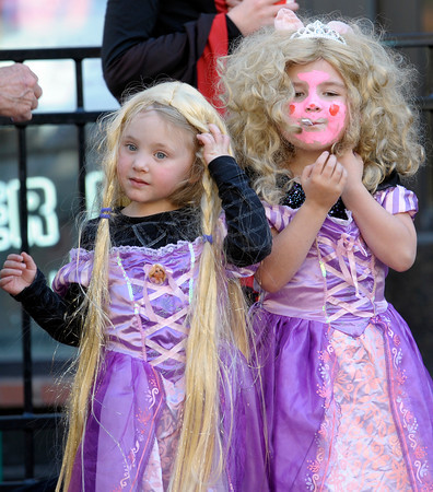 Matching princesses Kiera Hendricks (left), 4, and Thierra Norton (right), 4, trick or treat during the Munchkin Masquerade on the Pearl Street Mall in Boulder, Colorado October 31, 2011.  CAMERA/Mark Leffingwell