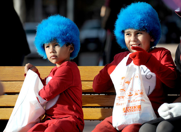 Jesus Medrano (left), 5, and Guillermo Medrano (right), 9, check out what's in their candy bags during the Munchkin Masquerade on the Pearl Street Mall in Boulder, Colorado October 31, 2011.  CAMERA/Mark Leffingwell