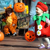 Dressed as a strawberry, Skyler Arnold, 12 months, enjoys the Munchkin Masquerade on the Pearl Street Mall in Boulder, Colorado October 31, 2011.  CAMERA/Mark Leffingwell