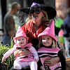 Diane Murphy (middle) poses for a photo with her granddaughters Fiona Lausten (left), 6 months, and Hadley Lausten (right), 3, during the Munchkin Masquerade on the Pearl Street Mall in Boulder, Colorado October 31, 2011.  CAMERA/Mark Leffingwell