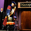 "Naropa University Provost and Vice President of Academic Affairs Stuart Sigman rings the gong to start Naropa's 2011 commencement ceremony on Saturday, May 7, at the Macky Auditorium on the University of Colorado campus in Boulder. For more photos and video go to  <a href=""http://www.dailycamera.com"">http://www.dailycamera.com</a><br /> Jeremy Papasso/ Camera"
