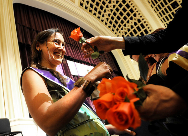 """Naropa University graduate Cheryl Burns, left, receives a flower after being awarded her diploma during Naropa's commencement ceremony on Saturday, May 7, at the Macky Auditorium on the University of Colorado campus in Boulder. For more photos and video go to  <a href=""""http://www.dailycamera.com"""">http://www.dailycamera.com</a><br /> Jeremy Papasso/ Camera"""