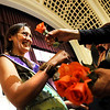 "Naropa University graduate Cheryl Burns, left, receives a flower after being awarded her diploma during Naropa's commencement ceremony on Saturday, May 7, at the Macky Auditorium on the University of Colorado campus in Boulder. For more photos and video go to  <a href=""http://www.dailycamera.com"">http://www.dailycamera.com</a><br /> Jeremy Papasso/ Camera"