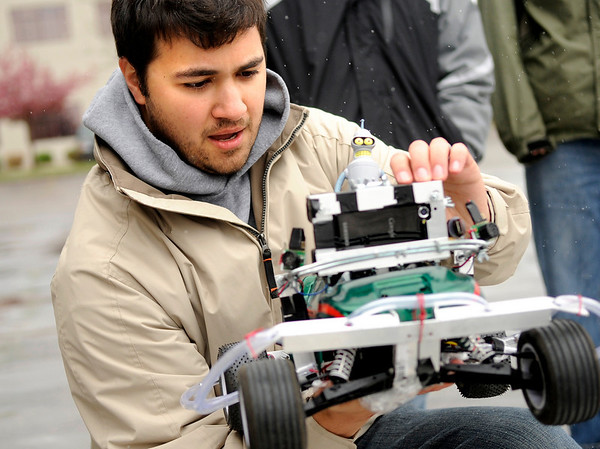 "Nasser Grainawi, of Erie, places his teams vehicle on the starting ramp during the 2011 SparkFun Autonomous Vehicle Competition on Saturday, April 23, in Boulder. Grainawi was part of Team ""Planet Express."" The competition is a race around the SparkFun building using vehicles, both on the ground and in the air, that navigate themselves with a GPS device and/or sensors. For more photos and video go to  <a href=""http://www.dailycamera.com"">http://www.dailycamera.com</a><br /> Jeremy Papasso/ Camera"