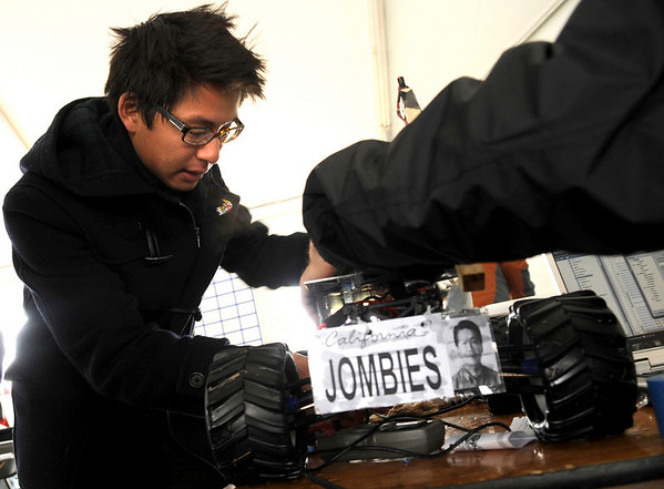 """University of California at San Diego student Frank Chang, left, puts the finishing touch on Team """"Jombies"""" vehicle during the 2011 SparkFun Autonomous Vehicle Competition on Saturday, April 23, in Boulder. The competition is a race around the SparkFun building using vehicles, both on the ground and in the air, that navigate themselves with a GPS device and/or sensors. For more photos and video go to  <a href=""""http://www.dailycamera.com"""">http://www.dailycamera.com</a><br /> Jeremy Papasso/ Camera"""
