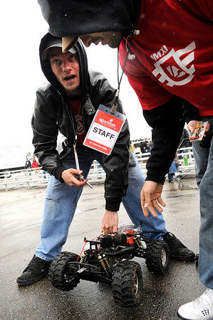 "SparkFun's Team Production members Jesse James, left, of Boulder, and Adam Silva, of Boulder, try to work out the kinks in their autonomous vehicle during the 2011 SparkFun Autonomous Vehicle Competition on Saturday, April 23, in Boulder. The competition is a race around the SparkFun building using vehicles, both on the ground and in the air, that navigate themselves with a GPS device and/or sensors. For more photos and video go to  <a href=""http://www.dailycamera.com"">http://www.dailycamera.com</a><br /> Jeremy Papasso/ Camera"