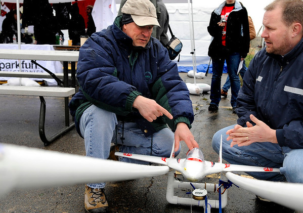 """Doug Weibel, of Longmont, left, talks with Paul Mather, of Cleveland, Ohio, about his game plan during the 2011 SparkFun Autonomous Vehicle Competition on Saturday, April 23, in Boulder. Weibel and Mather were competing as Team """"Death By Pine Tree.""""<br /> The competition is a race around the SparkFun building using vehicles, both on the ground and in the air, that navigate themselves with a GPS device and/or sensors. For more photos and video go to  <a href=""""http://www.dailycamera.com"""">http://www.dailycamera.com</a><br /> Jeremy Papasso/ Camera"""