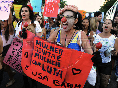 "Women participate at the ""Marcha das vadias"", inspirated by the Slut Walk, a march against sexism and in favor of women's rights wich started in Canada and has been spreading all around the world, at the Copacabana beach, Rio de Janeiro, Brazil, May 26, 2012. Women at the ""Marcha das vadias"" in Rio complain about the high rates of violence against women in Brazil. (Austral Foto/Renzo Gostoli)"