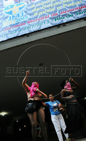 "A woman protests in front of a catholic church against the abortion prohibition by the Catholic Church during the ""Marcha das vadias"", inspirated by the Slut Walk, a march against sexism and in favor of women's rights wich started in Canada and has been spreading all around the world, at the Copacabana beach, Rio de Janeiro, Brazil, May 26, 2012. Women at the ""Marcha das vadias"" in Rio complain about the high rates of violence against women in Brazil. (Austral Foto/Renzo Gostoli)"