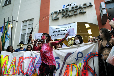 "Women protest in front of a police station during the ""Marcha das vadias"", inspirated by the Slut Walk, a march against sexism and in favor of women's rights wich started in Canada and has been spreading all around the world, at the Copacabana beach, Rio de Janeiro, Brazil, May 26, 2012. Women at the ""Marcha das vadias"" in Rio complain about the high rates of violence against women in Brazil. (Austral Foto/Renzo Gostoli)"