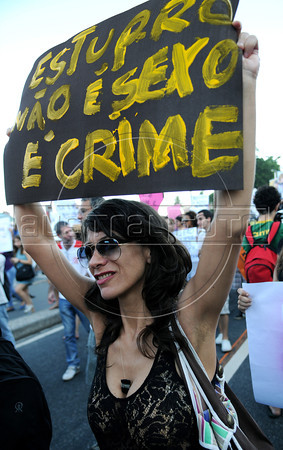 "A woman participates at the ""Marcha das vadias"", inspirated by the Slut Walk, a march against sexism and in favor of women's rights wich started in Canada and has been spreading all around the world, at the Copacabana beach, Rio de Janeiro, Brazil, May 26, 2012. Women at the ""Marcha das vadias"" in Rio complain about the high rates of violence against women in Brazil. In the banner says ""Rape is not sex, is crime"". (Austral Foto/Renzo Gostoli)"