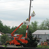 OG+E crews work on a  power line at Jones Ave. and Tonawa St, Friday, April 13, 2012, downed after a tornado skipped through Norman. Photo by Jerry Laizure