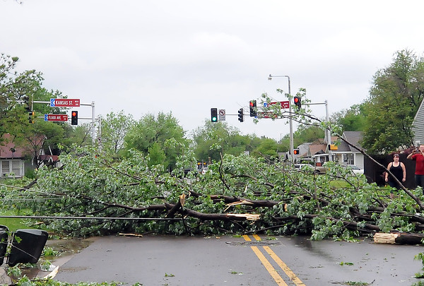 Trees block Flood Ave. Friday, April 13, 2012,  after a tornado skipped through Norman. Photo by Jerry Laizure