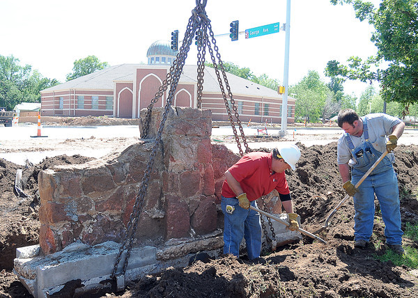 University of Oklahoma Facilities Management workers Marty Jackson, Jr. (left) and Marty Jackson III were busy Tuesday, April 24, 2012, reinstalling stone monuments along east Lindsey Street as the widening project wraps up. Weighing about 1300 pounds each, the monuments surround the duck pond and were a Works Projects Administration (WPA) project in the 1930s. Photo by Jerry Laizure