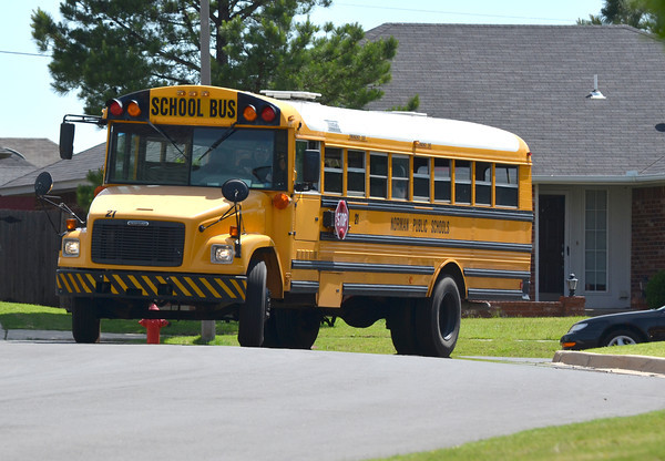 A Norman school bus rounds the corner after dropping off children after their school day Wednesday afternoon.<br /> Transcript Photo by Kyle Phillips