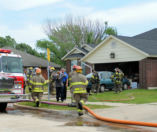 Moore fire units responded to a minor fire at a residence in the 3800 block of Shannon St. Thursday, April 19, 2012. No injuries were reported. Photo by Jerry Laizure