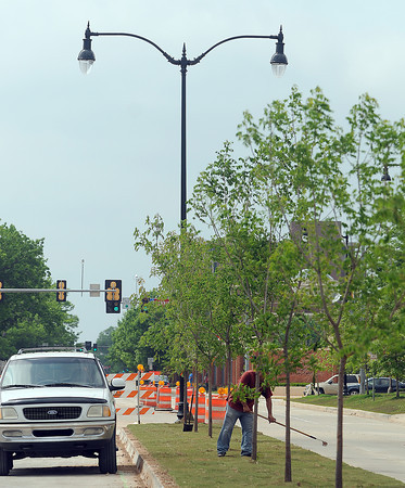Crews are busy landscaping the median on the newly widened stretch of Lindsey St. east of Jenkins Ave. New light poles, treees and sod have been added recently to the street from Lincoln Ave. to the railroad tracks. Photo by Jerry Laizure
