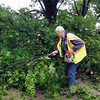 City crews were busy, Friday, April 13, 2012, removing debris from the streets after a tornado skipped through Norman. Photo by Jerry Laizure