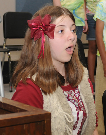 The Norman Childens Chorus is preparing for it's 20th anniversary program. Rehearsing Anna Serven. Photo by Jerry Laizure