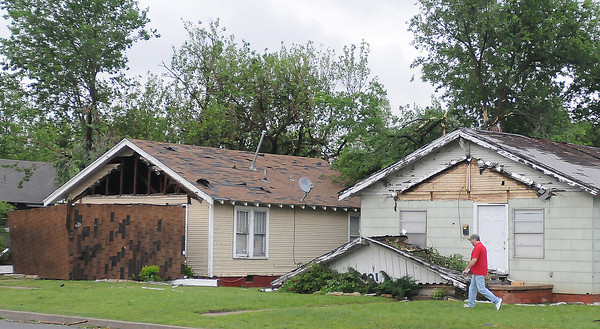 These houses on Flood Ave. north of Gray St. had roof and porch damage caused by a tornado Friday, April 13, 2012, that touched down at 24th Ave. SW and bounced to the neighobrhood east of Norman High School. Photo by Jerry Laizure