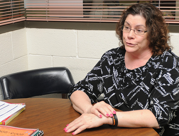 Charlie Mason, principal at Dimensions Academy, sits for an interview Wednesday, April 25, 2012. Mason is retiring. Photo by Jerry Laizure