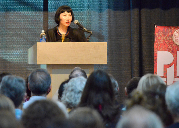 """Amy Tan, author of """"The Joy Luck Club"""", speaks at the Sam Noble Museum on the University of Oklahoma campus during the Big Read event Friday.<br /> Transcript Photo by Kyle Phillips"""