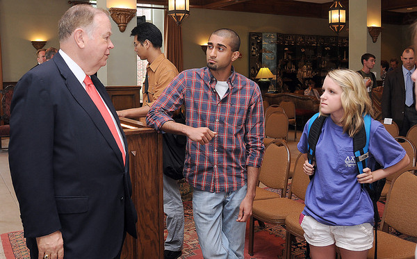 University of Oklahoma president David L. Boren (left) visits with students Akash Patel (center) and Emma Lindgren Monday, April 30, 2012, after his talk about OU's budget. Photo by Jerry Laizure