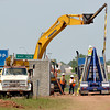 Workers unload concrete walls Wednesday afternoon that will serve as a sound proof barrier between houses and the noise that Interstate 35 causes.  The I-35 sound wall Project from Main Street to approximately 1200 feet north of Lindsey Street is a $1.4 million project managed by ODOT with Manhattan Road and Bridge Construction Company of Oklahoma City as their contractor.  This project is anticipated to be complete by early fall.<br /> Transcript Photo by Kyle Phillips