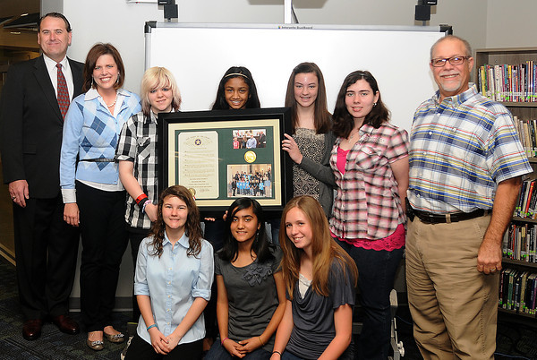 State Sen.  John Sparks (left) presented the Whittier botball team and administrators with a proclamation (also sponsored by Rep.Emily Virgin) for their first place win in national competition. The robot is currently on display at the Smithsonian Institution. Accepting the proclamation are (second from left) Principal Holly Swanson, Alice Leidy,Veena Muraleetharan, Hannah Curtis, Emily King and Botball Mentor Charlie Bevers; and (front row, from left)  Cheyenne Collins, Prachi Khanna, Dannye Carpenter not pictured Rebekah Clayton. Photo by jerry Laizure