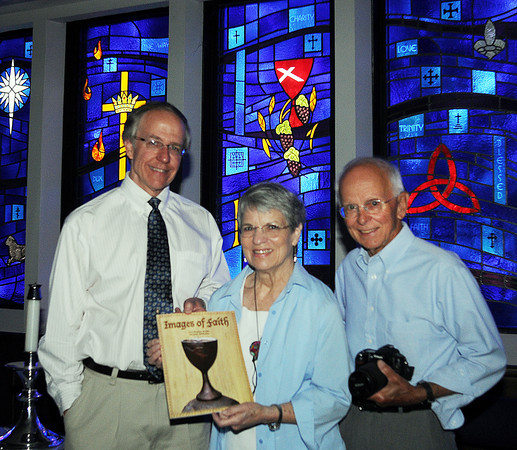 First Christian Church congregation members Sara Davis (center) and George Ingels (right) and Sr. Minister David Spain pose with the book Davis and Ingels produced, Images of Faith. The book features photos of religious art taken by Ingels and descriptions written by Davis. Photo by Jerry Laizure