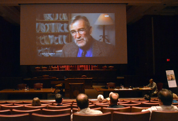 Visitors watch a movie as retired CIA analyst Ray McGovern gives a lecture at the Dick Bell Courtroom at the OU College of Law Sunday afternoon about misinformation in the Iraq War and  heading off war with Iran.<br /> Transcript Photo by Kyle Phillips