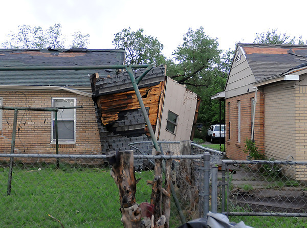 Houses on North Base Ave. east of Norman High sustained structural damage, Friday, April 13, 2012, after a tornado touched down. Photo by Jerry Laizure