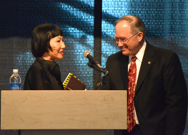 Paul Bell, dean of the OU College of Arts and Sciences, welcomes Amy Tan to the stage as she prepares to spea to an audience at the Sam Noble Museum Friday for the Big Read.<br /> Transcript Photo by Kyle Phillips