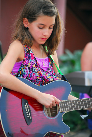 "Willow Arana plays the guitar as she plays a show with the band ""Grey Street"" as they perform Friday evening at the Kids Corner during the 2nd Friday Art Circuit. Kyle Phillips/The Transcript"
