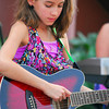 "Willow Arana plays the guitar as she plays a show with the band ""Grey Street"" as they perform Friday evening at the Kids Corner during the 2nd Friday Art Circuit.<br /> Kyle Phillips/The Transcript"