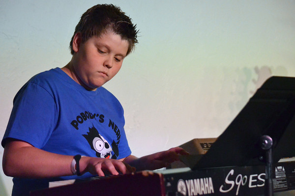 """RJ Bently plays """"Zelda's Lullaby"""" on the piano Saturday afternoon at the Norman Music Institute's Student Showcase.<br /> Kyle Phillips/The Transcript"""