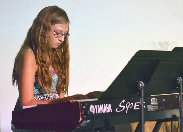 "Erin Sharpe plays ""The Donkey Song"" on the piano Saturday afternoon at the Norman Music Institute's Student Showcase.<br /> Kyle Phillips/The Transcript"