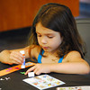 Reese Fleming sticks designs on her bied-themed bookmark she is making during Bird Day at Discovery Cove Nature Center at Lake Thunderbird.<br /> Kyle Phillips/The Transcript