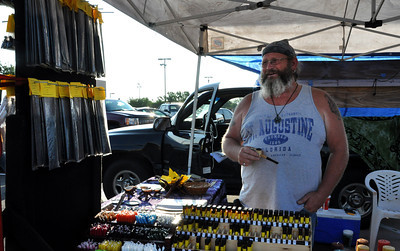 Harlan Bell, owner of Bell's Mystical Beginnings, sells spiritual items such as candles, oils, incence, and jewelry at the Farmers Market on Saturday. The Farmers Market is held every Wednesday and Saturday from 9 to noon at the Cleveland County Fairgrounds. Julie Bragg/ The Transcript