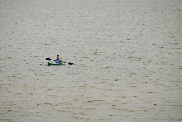 A Kayaker paddles around Lake Thunderbird Saturday afternoon trying to beat the heat that has plagued Norman for the last few weeks.  By Monday, forecasters at the National Weather Service are predicting the heat will break, bringing much need relief to the area.<br /> Kyle Phillips/The Transcript