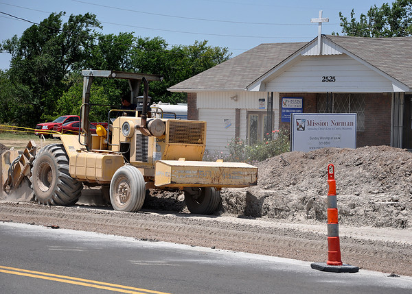 Road construction in front of Mission Norman on E Lindsey St and SE 24th St on Tuesday. Julie Bragg/ The Transcript