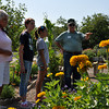 Master Gardeners Cathy Whittle and Fred Schnider give Sarah Spellman and Courtney Gates a tour of the Zoo Garden, a part of the Master Gardener's Garden at the Cleveland County Fairgrounds on Wednesday. The garden is open for free tours on Wednesdays and Saturdays from 9 to noon. Julie Bragg/ The Transcript