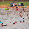 Swimmers play in the water at Lake Thunderbird Saturday afternoon, trying to beat the heat that has plagued Norman for the last few weeks.  By Monday, forecasters at the National Weather Service are predicting the heat will break bringing much need relief to the area.<br /> Kyle Phillips/The Transcript