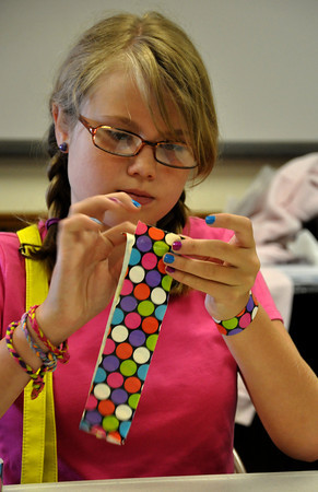 Elizabeth Morrow aligns her duct tape to create a wallet on Friday. During the workshop 4-H members learned how to make duct tape bracelets, wallets and pencil bags. Julie Bragg/ The Transcript