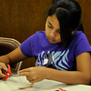 Shivani Kim sizes her duct tape bracelet to fit her wrist on Friday, during a duct tape workshop lead by Annie Bragg. Julie Bragg/ The Transcript